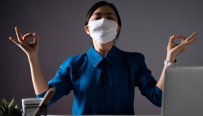 asian-woman-wearing-protective-face-mask-calms-down-breathes-deeply-picture-id1254186714