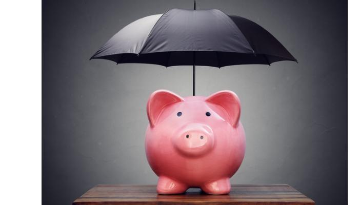 financial-insurance-or-protection-piggy-bank-with-umbrella-picture-id505029896