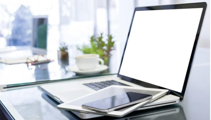 laptop-computer-with-blank-white-screen-and-digital-tablet-on-table-picture-id1204155680